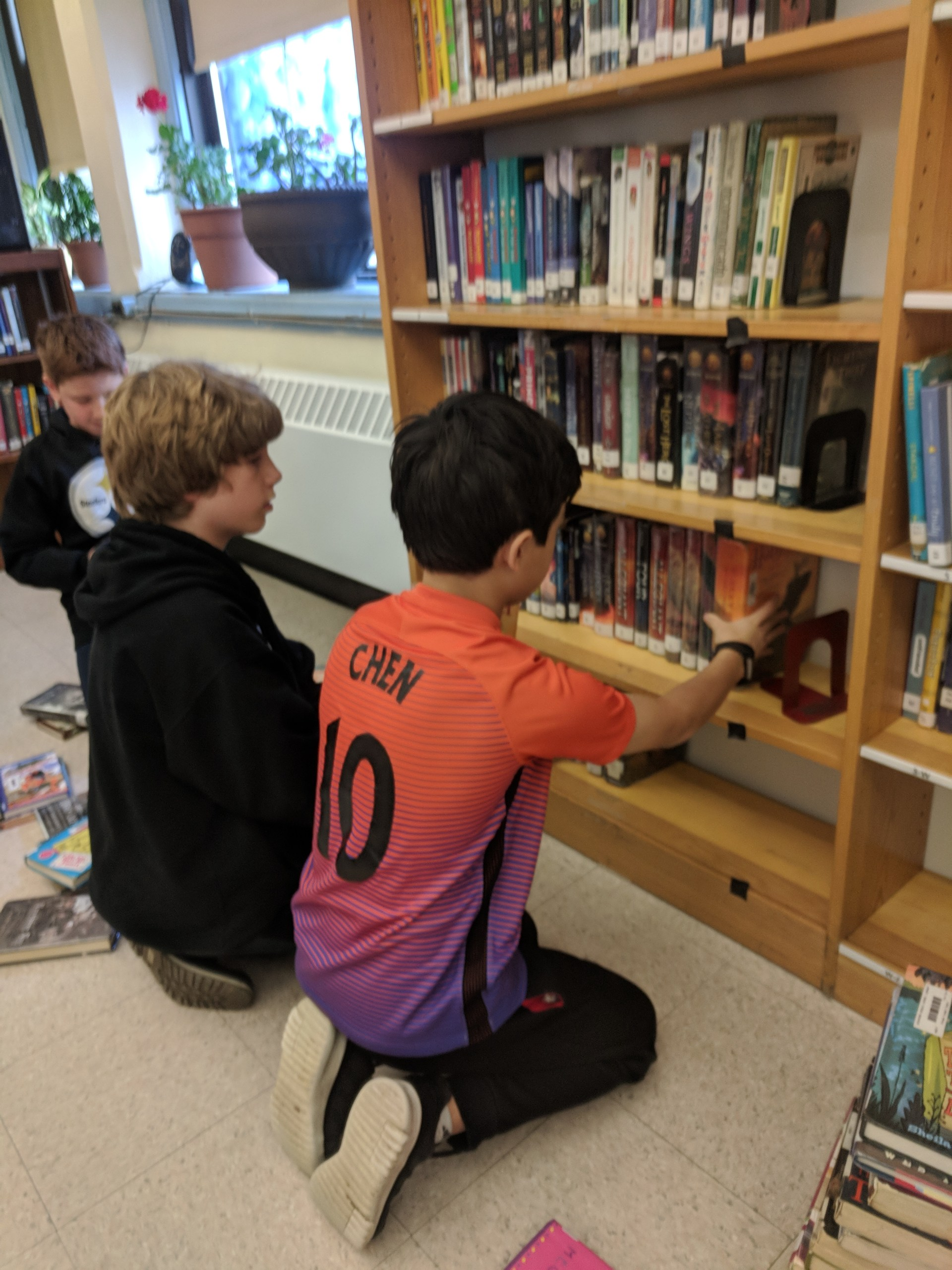 students helping in the library