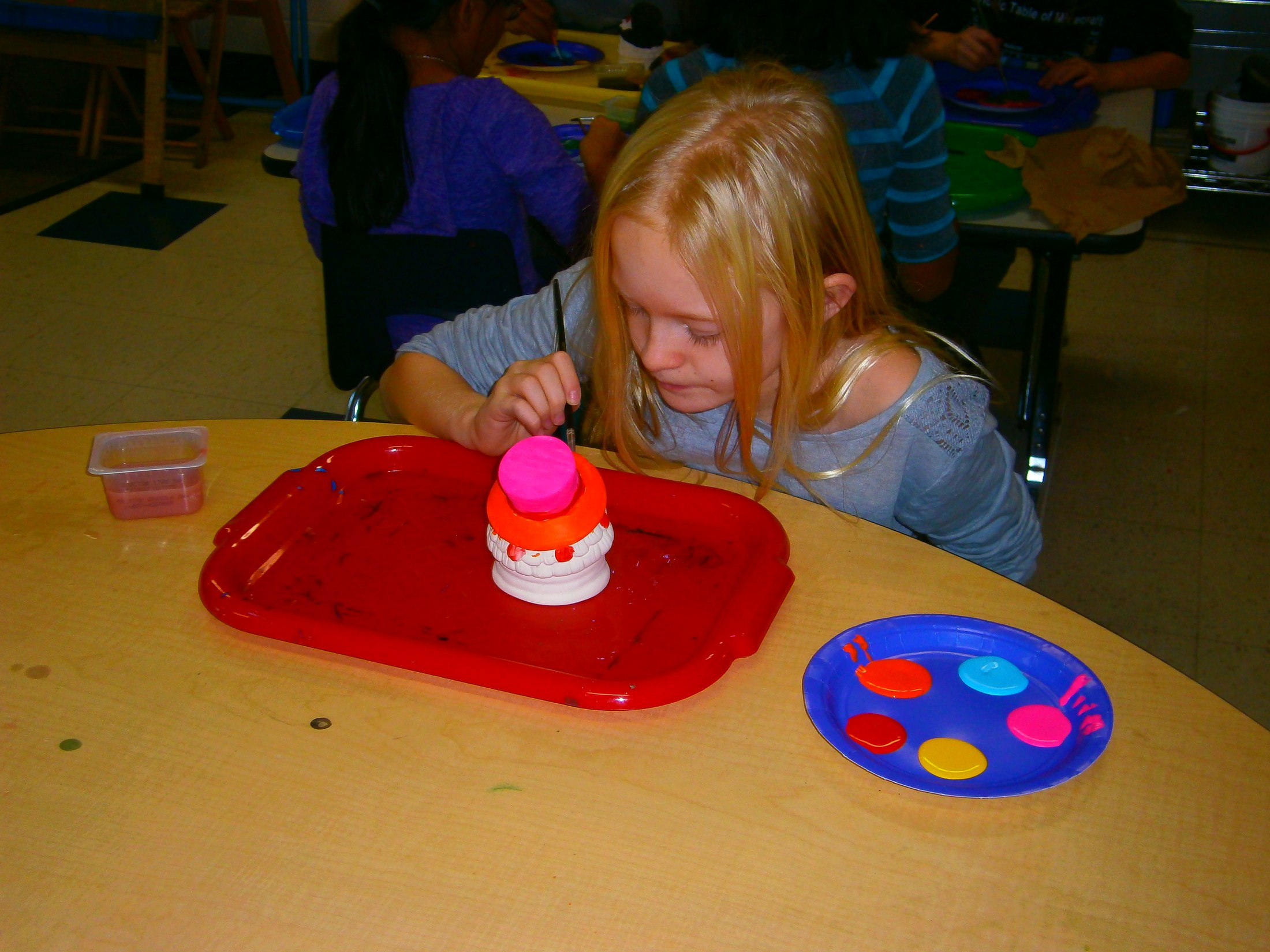 Painting a bowl in Kids' Club.