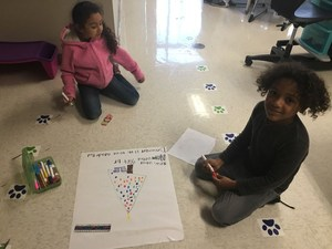 SGE students creating posters for the Hurricane Harvey Gift Drive.