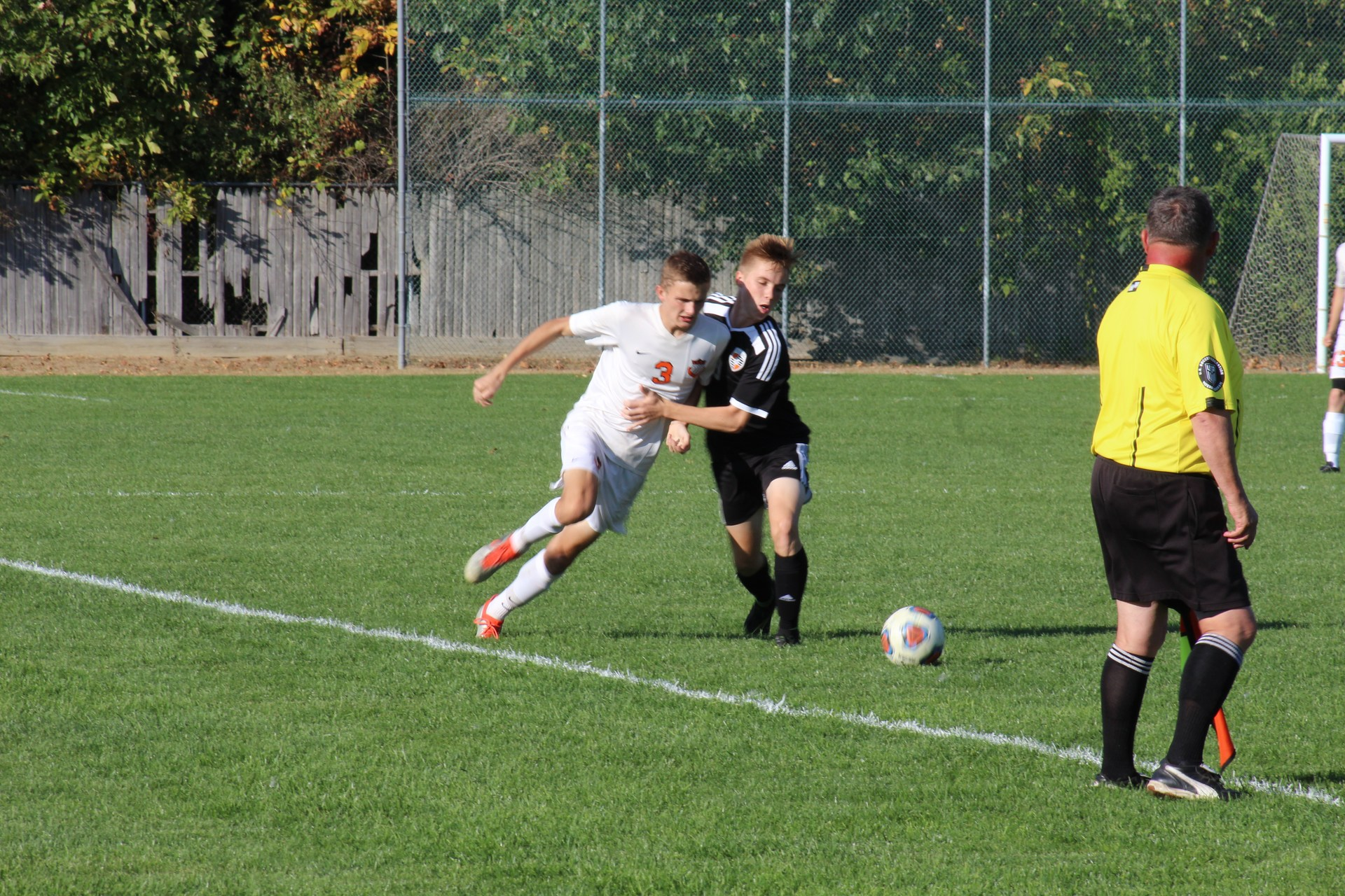 Photo of Clio and Flushing boys soccer players battling for the ball