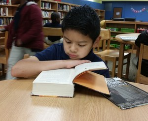 South City library, boy with book