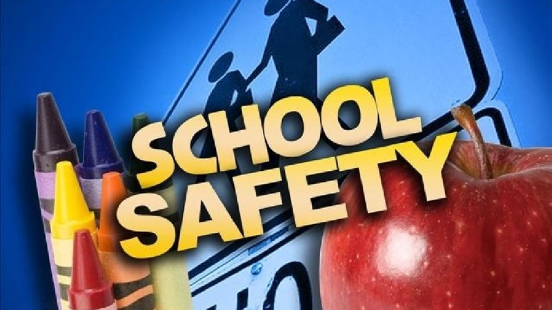 School Safety logo with apple and crayons