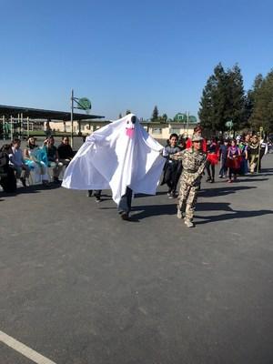 A teacher in a ghost emoji costume during the costume parade.