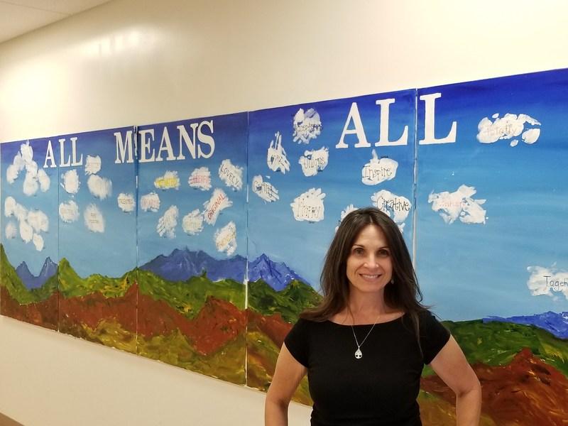 Susan Hohweisner in front of a Hemet High wall
