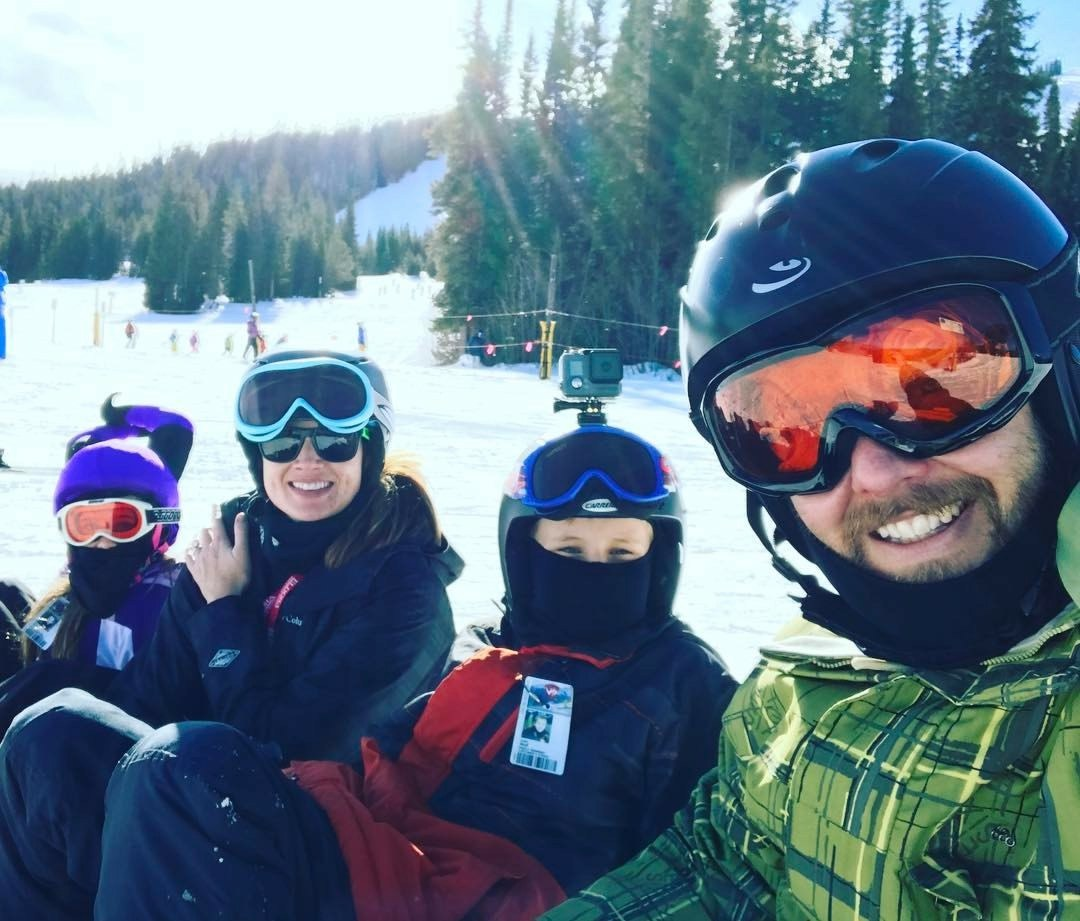 Mr. Wolf's family snowboarding.