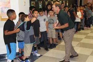 Adams Teacher Brad Rogers interacts with students on the first day of school