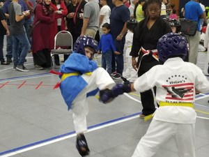 Karate Student kicking during tournament