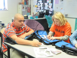TKMS students decorate duffel bags for foster children.