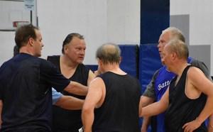 2016 Alumni Basketball Tournament team huddle