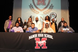 HS football players sign their letters of intent to play college ball with family members.