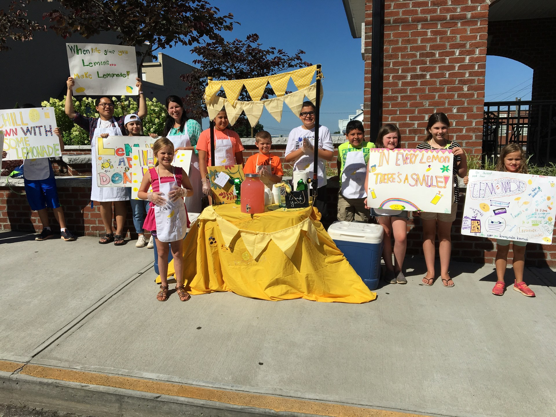 Summer camp students running a lemonade stand