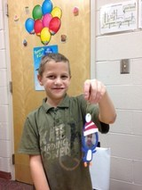 Photo of student with completed ornament.