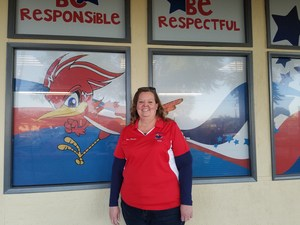 Jennie Farmer in front of the the Ramona Roadrunner