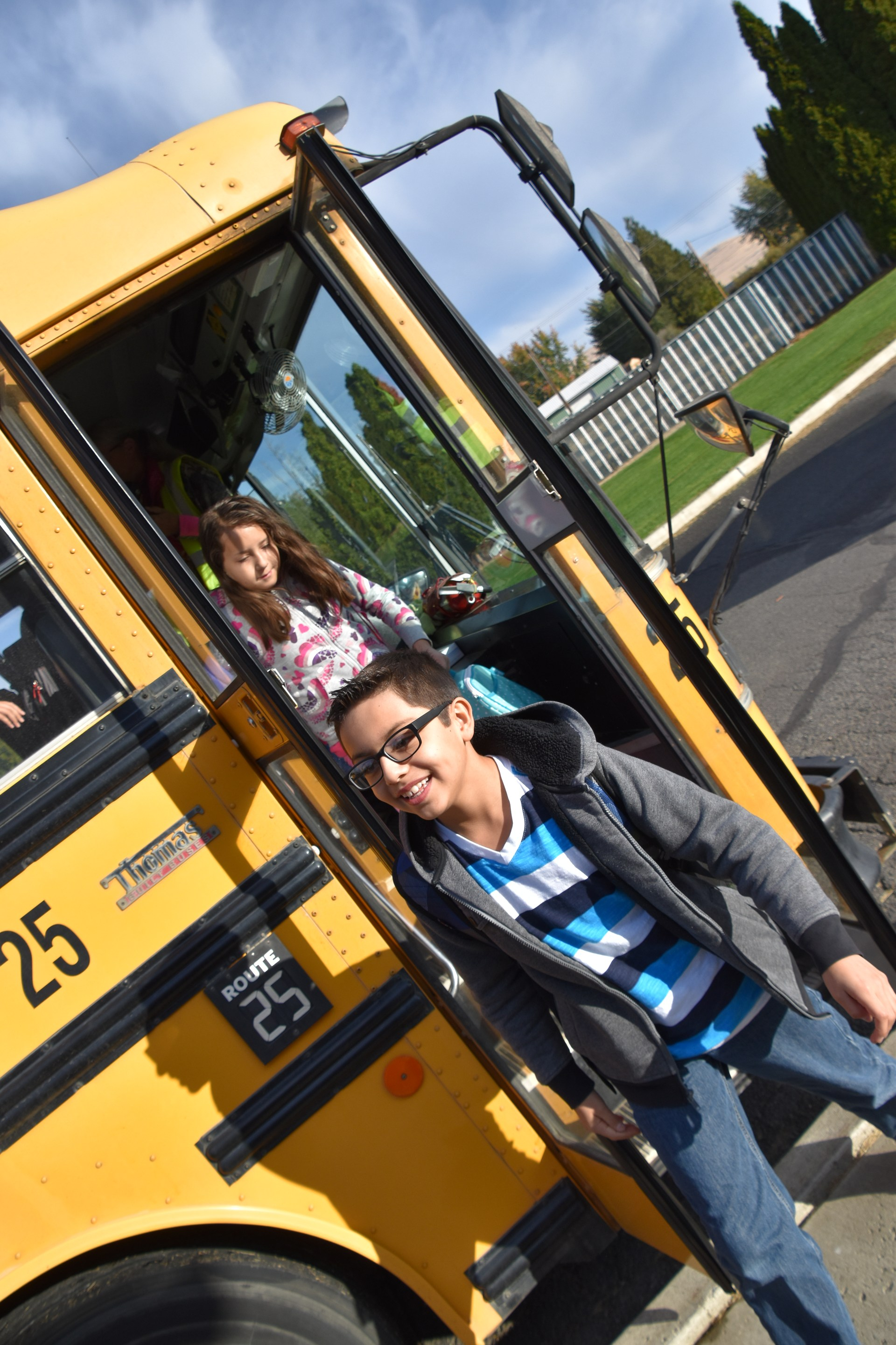 A student getting off of one of our school buses at East Valley Elementary.