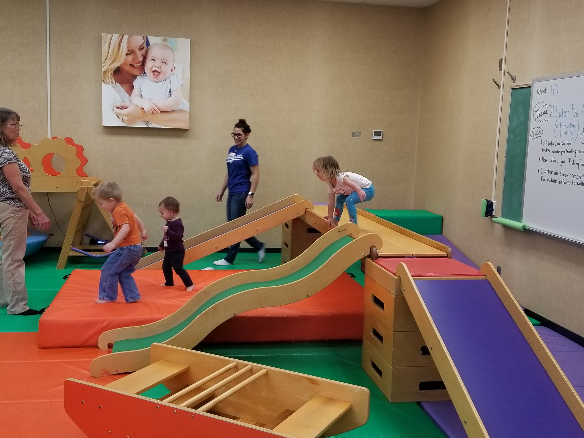 Children playing on Gymboree slides