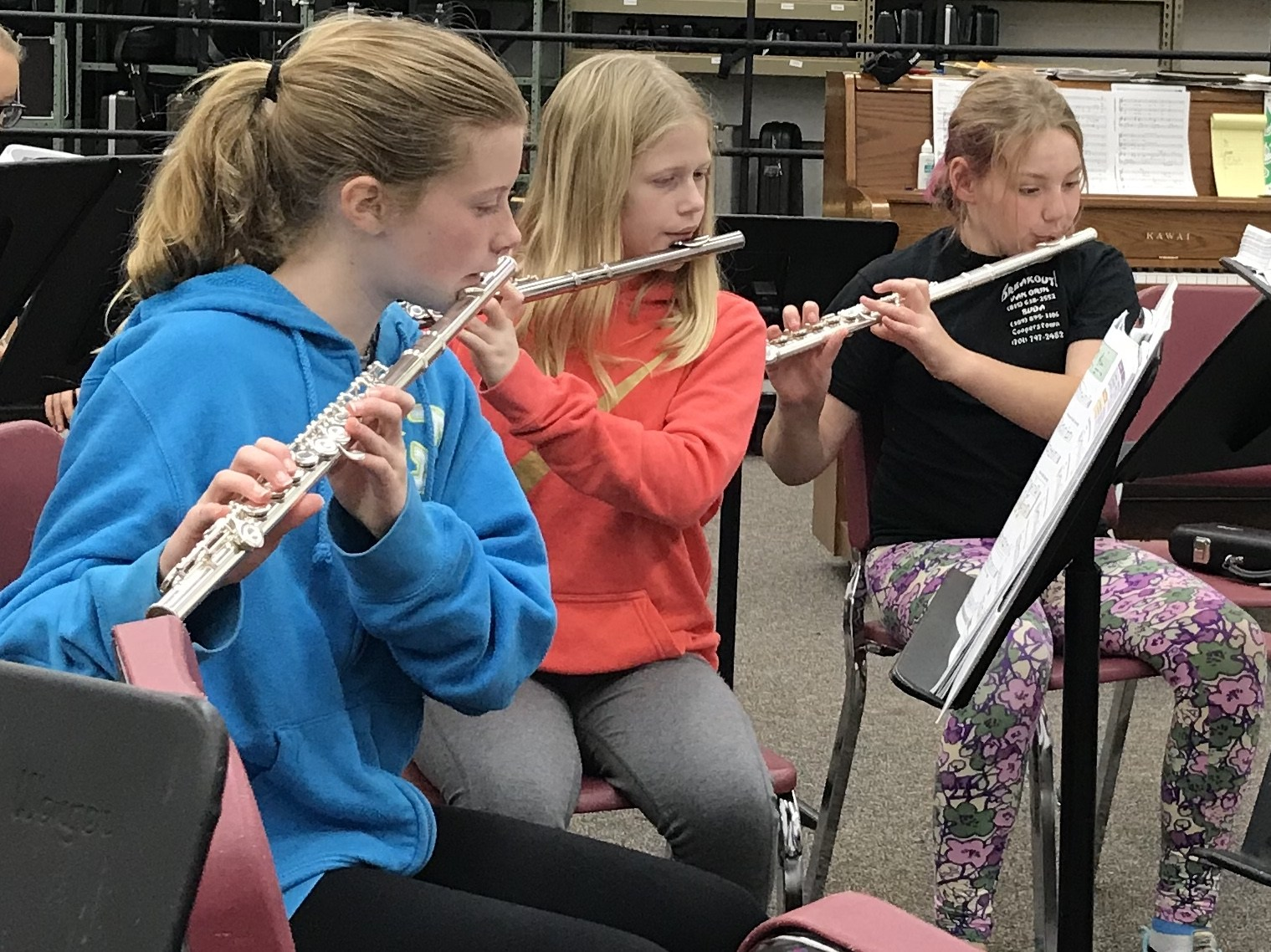 Three students playing flute