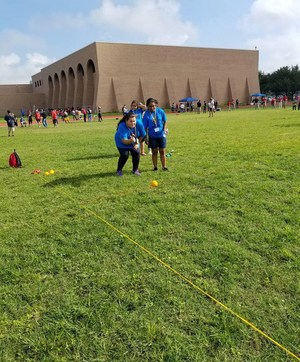 A Bocce athlete and partner in action.