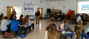 Principal Riggitano addresses 8th graders.jpg
