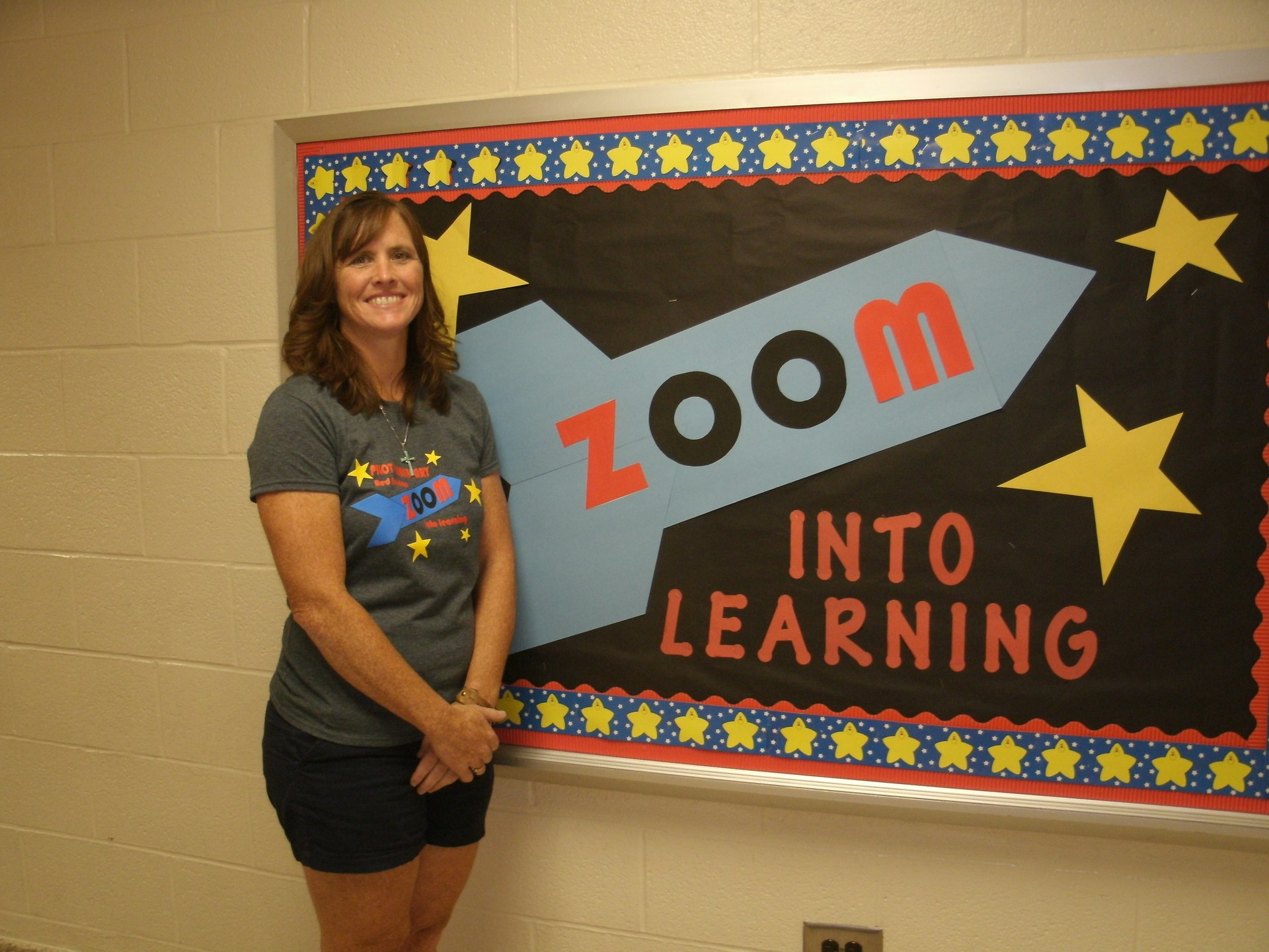 Heather Cook is standing in front of a bulletin board.