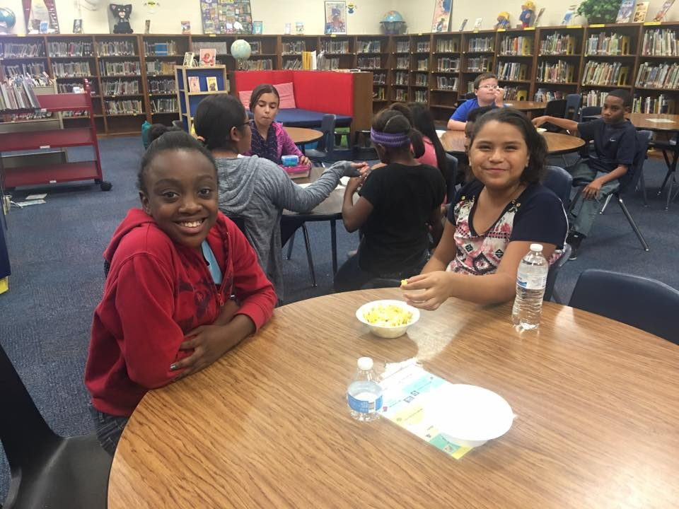 Cooking Club members enjoy the meal they prepared.