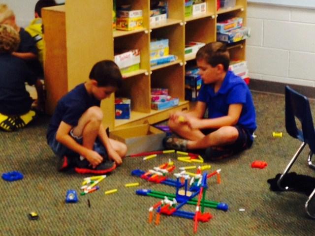 Boys building with legos.