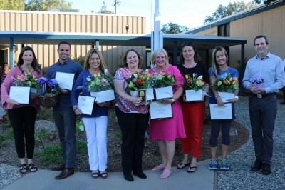 group of district and school volunteers of the year in front of the district office