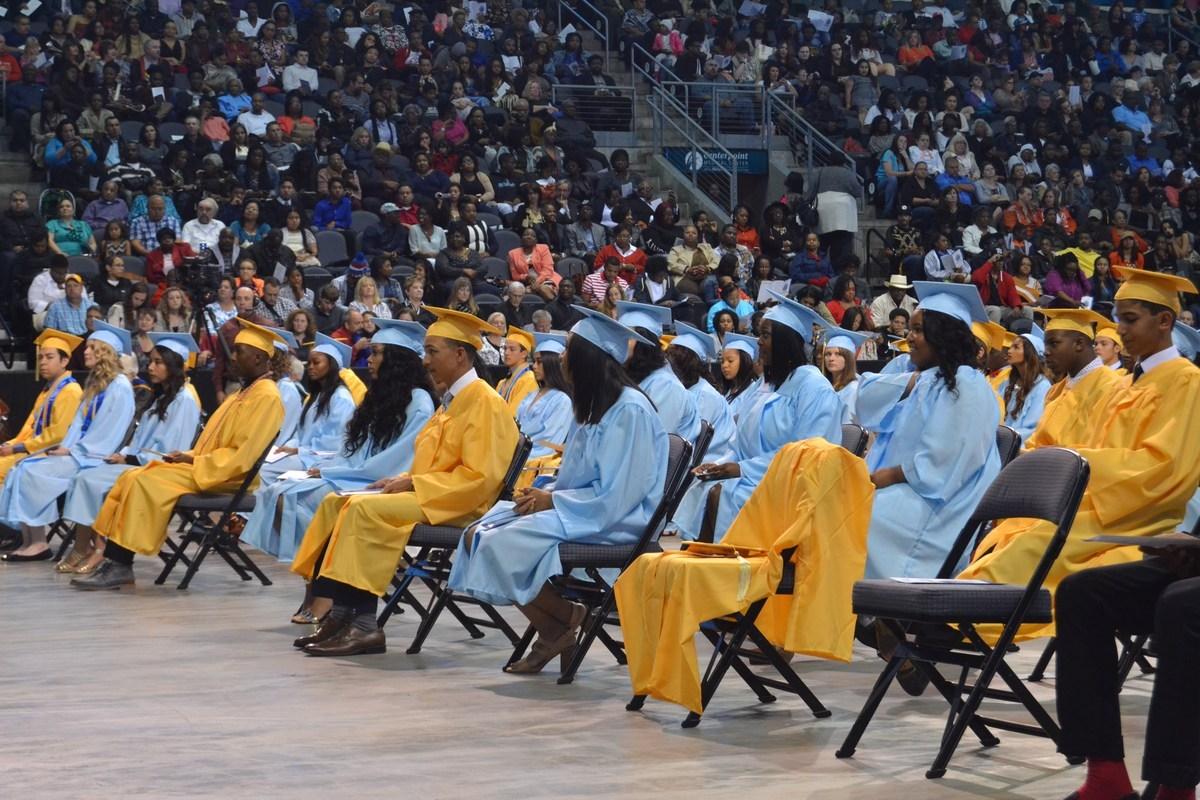 Students sitting at graduation.