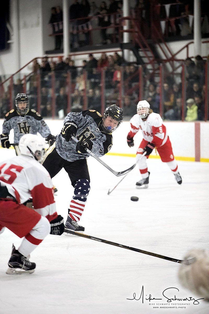 CHS hockey player shoots the puck