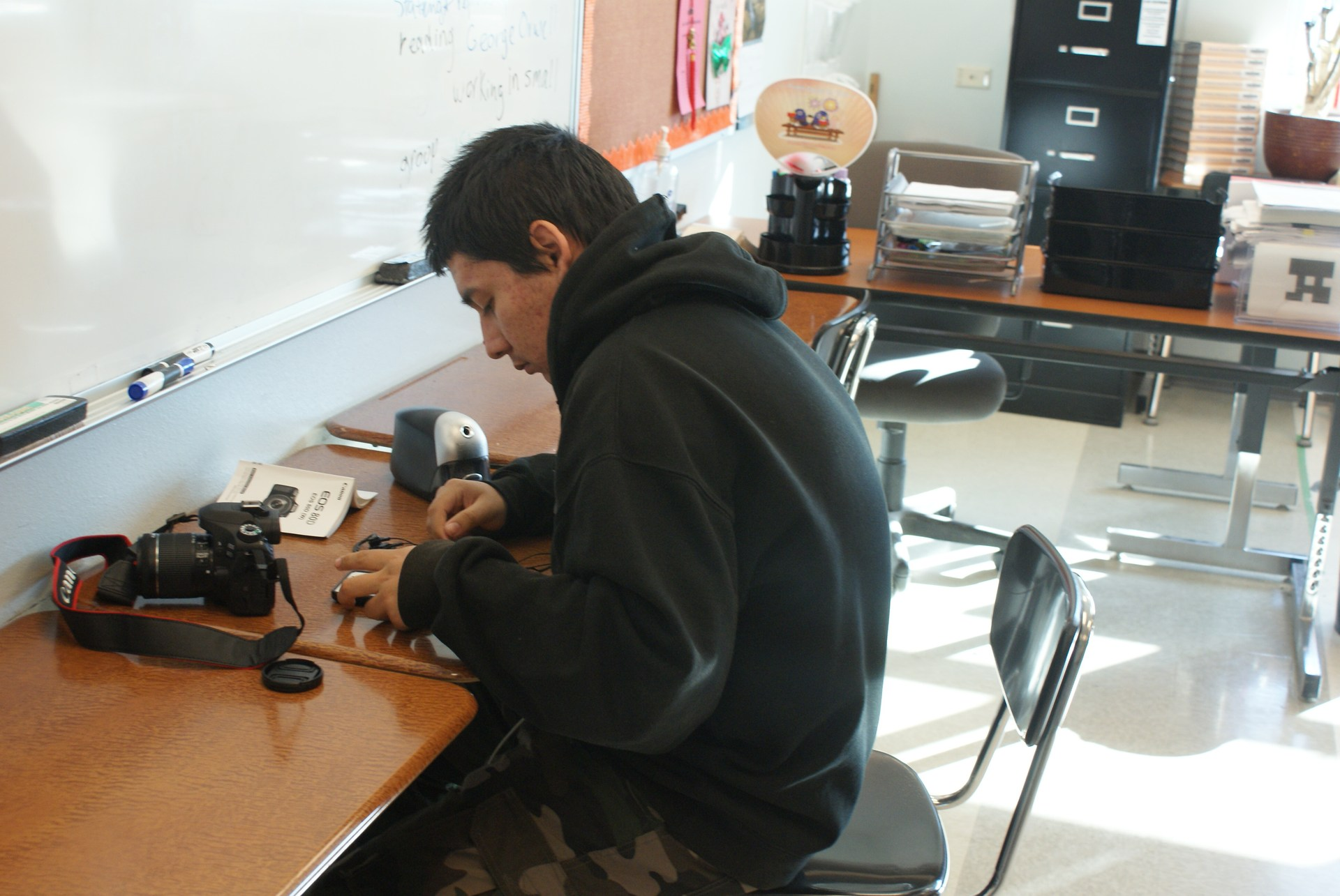 Student prepares camera for video shoot.