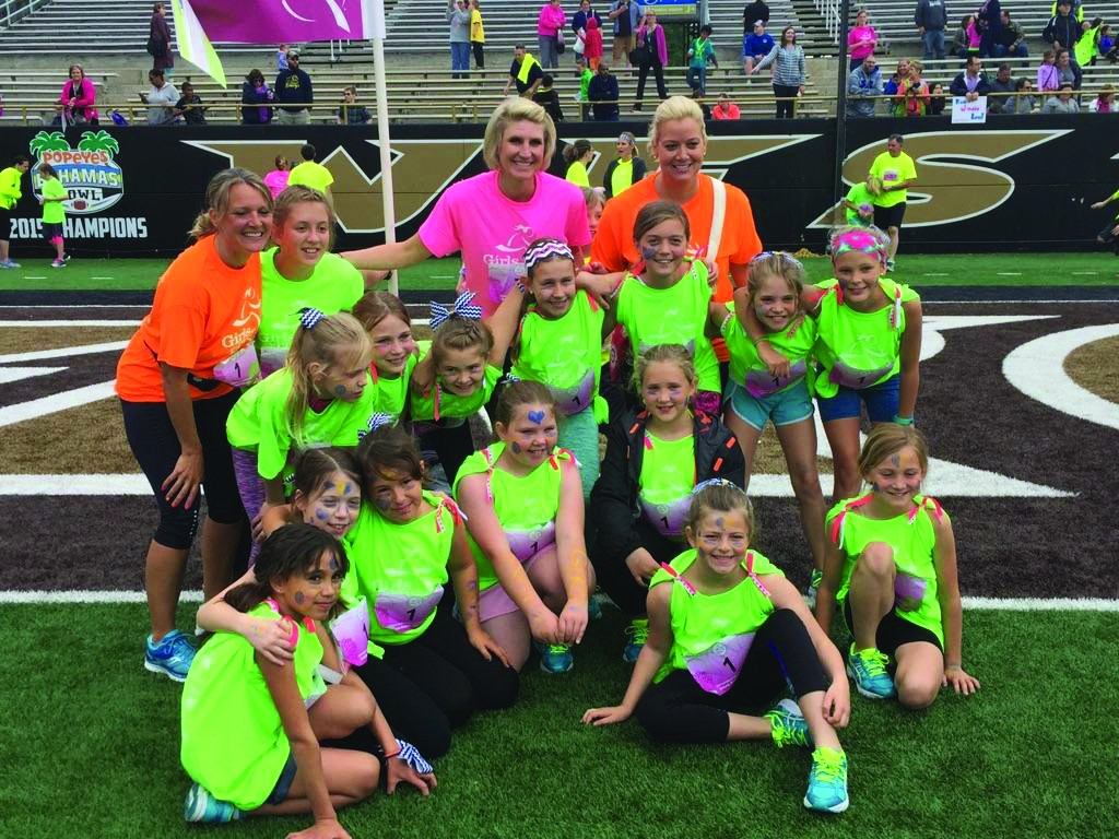 Alamo Girls on the Run members get together for a team picture at the 5K event.