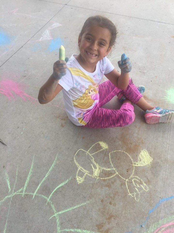 Student with sidewalk chalk