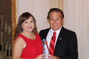 Pictured are City of Alton Mayor Salvador Vela presenting Ms. Criselda Valdez, MCISD Interim Superintendent, the Helping Hand Award on behalf of the school district.