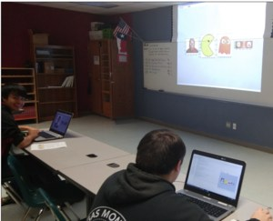 Picture 2: Shown on left is junior Agustin Andrade and on right senior Wesley Monk. On Wesley's computer, you can see the python code editor on the left side of his screen and his output window on the right.