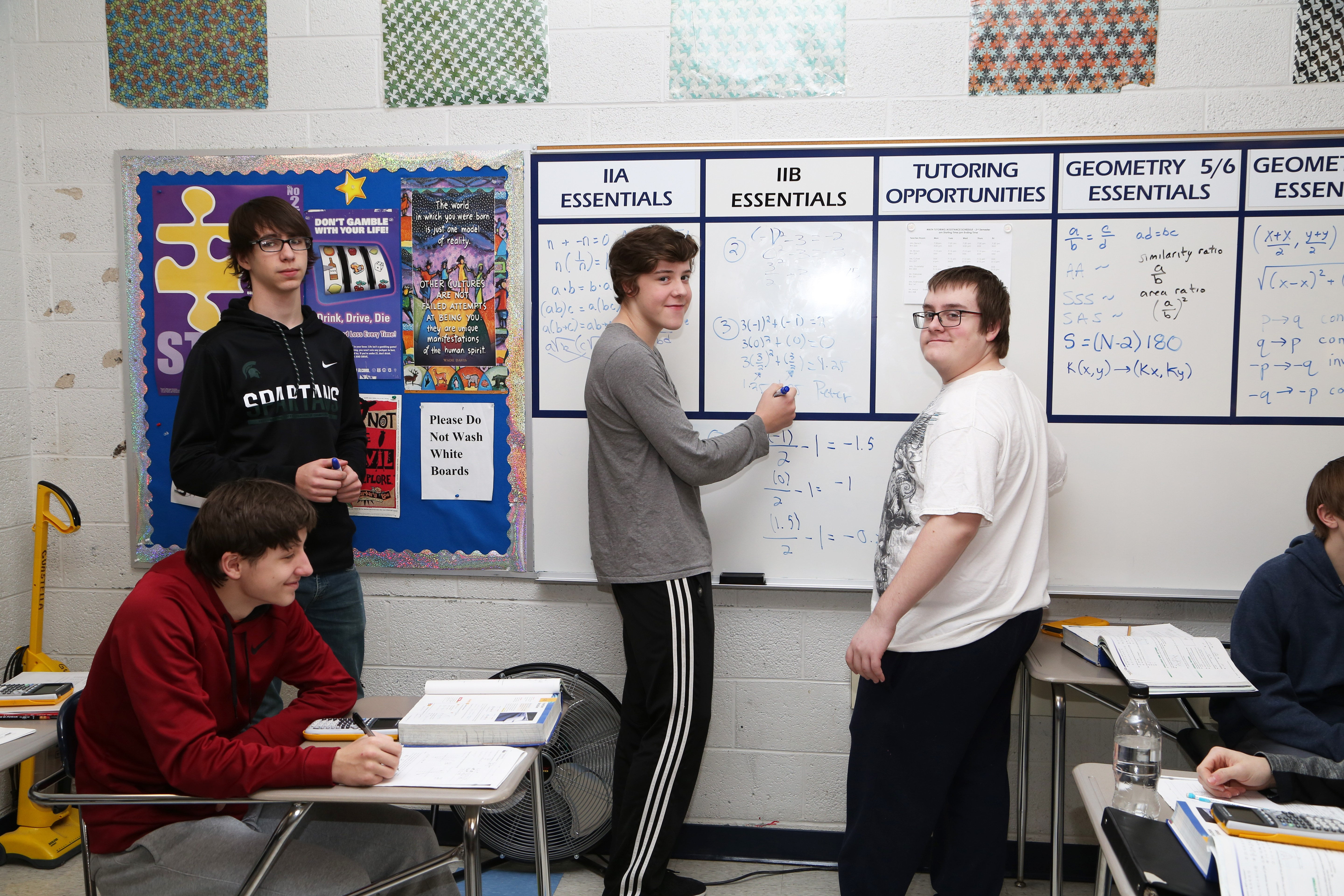 Math Class students solving math problems on the board