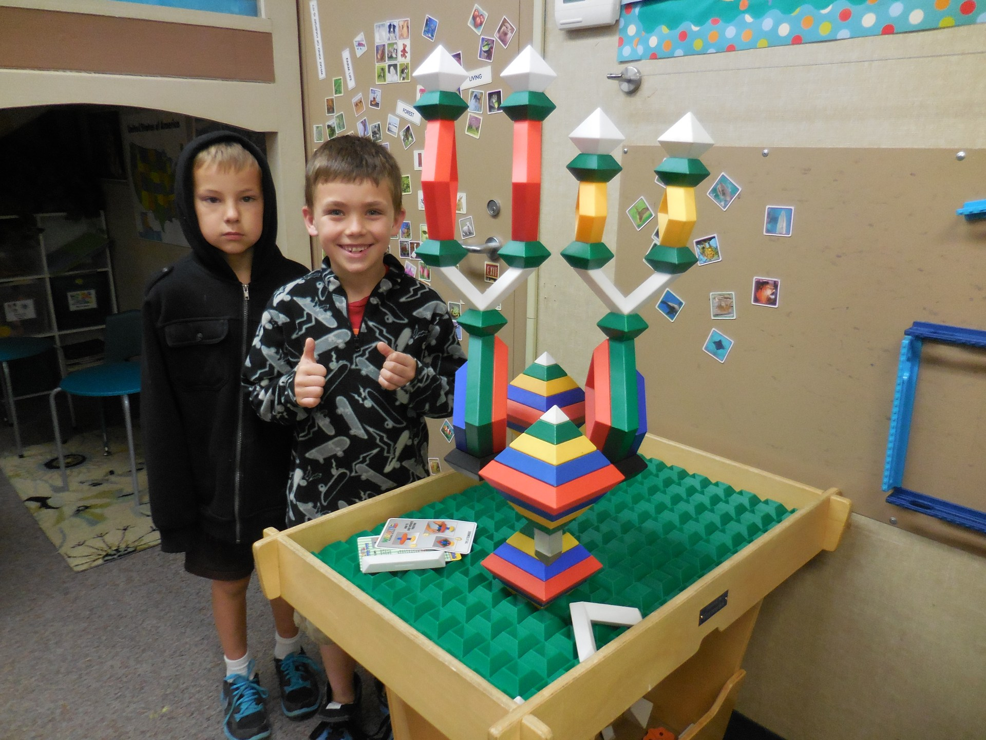 Two students stacking toys