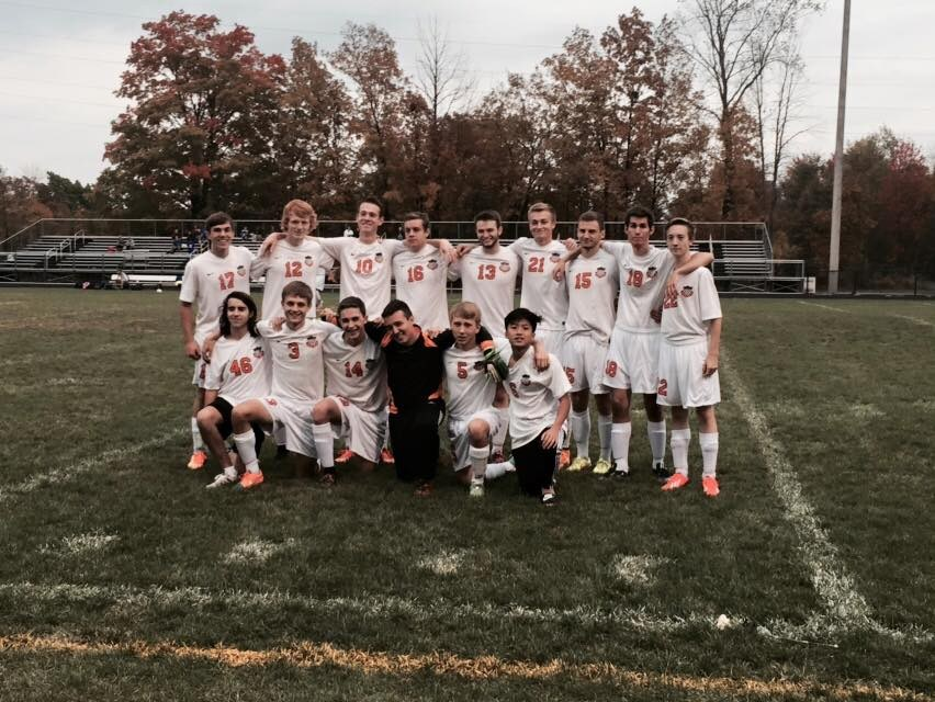 Photo of boys soccer team posed in group