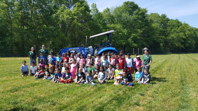 2nd graders in front of tractor
