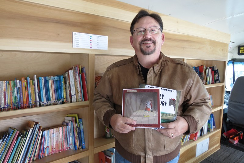 Dan Reidmiller donates his two books to the bookin bus