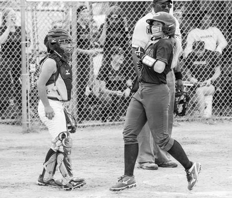 Coloma's Nicolle Larson is all smiles as she steps on home plate after a double hit by Jenna Walter during the Division 3 district softball championship game against Hartford on Saturday.