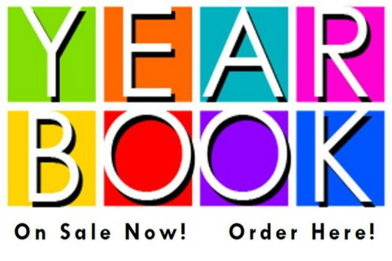 Sign with color blocks on it that say Year Book On sale now! Order Here!