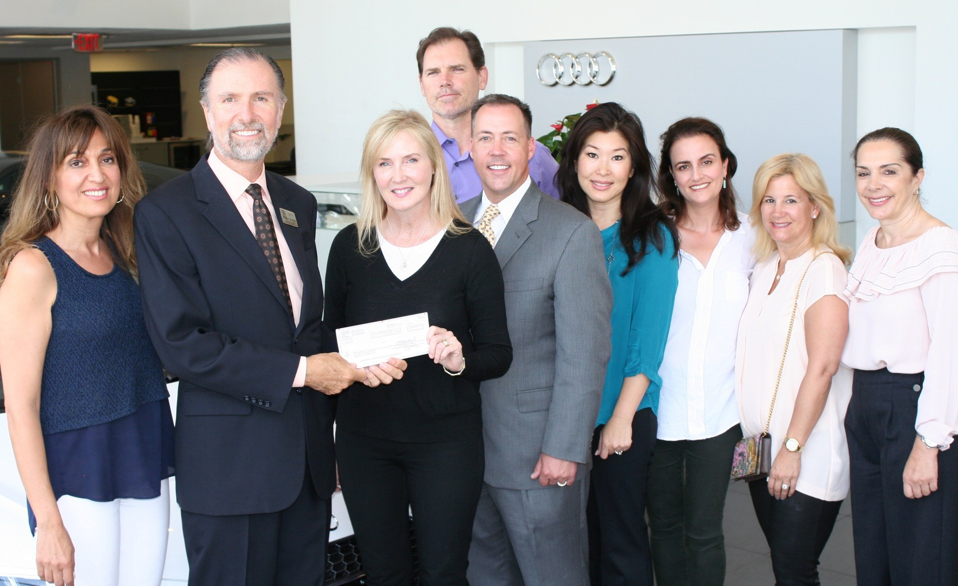 Audi check presentation with general manager and BHEF board members.