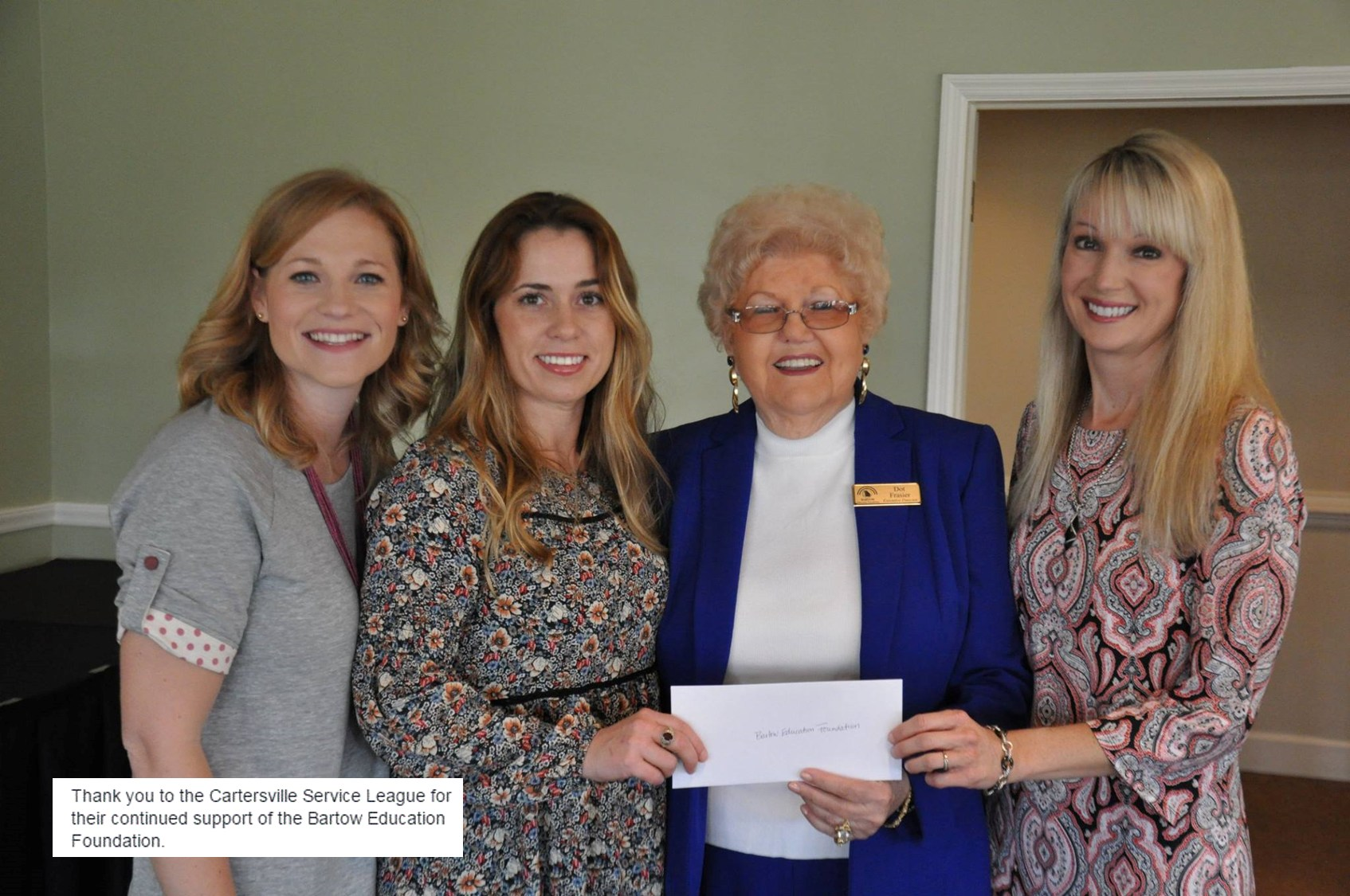 Ms. Dot with Cartersville Service League present check