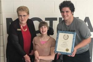 Cole George wins service award.