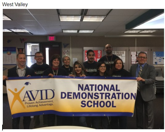 Photo of West Valley High AVID Staff Members holding their National Demonstration School banner
