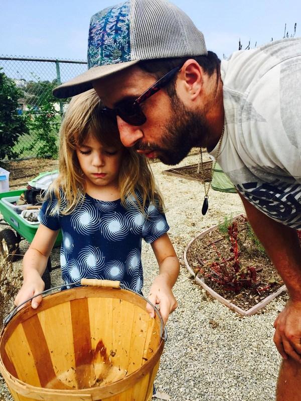 Farmer Matt works with young gardner