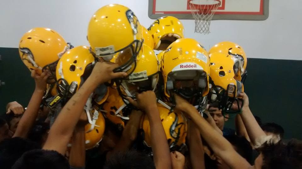 Players holding up helmets