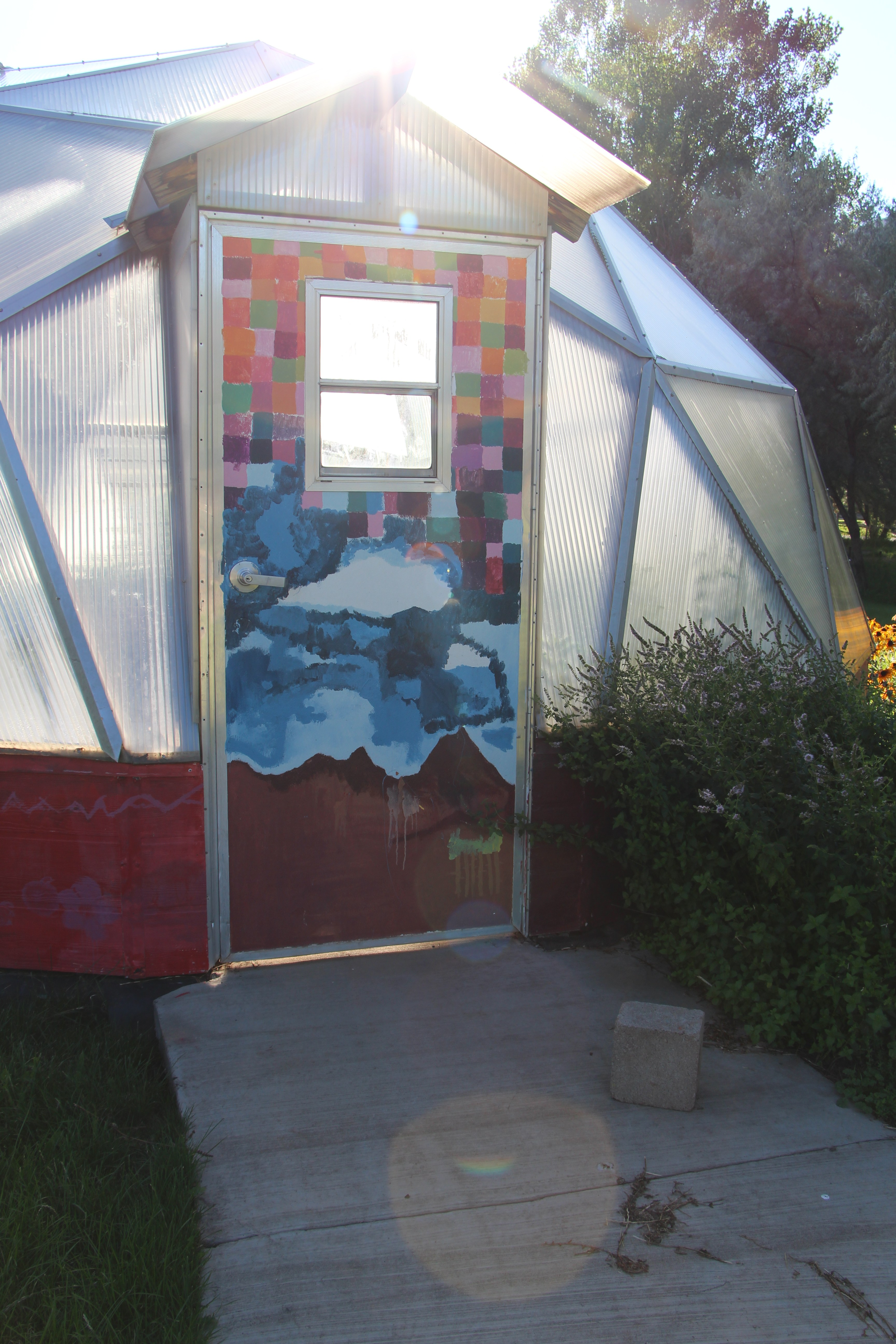 Mural on the door to the Animas Valley greenhouse.
