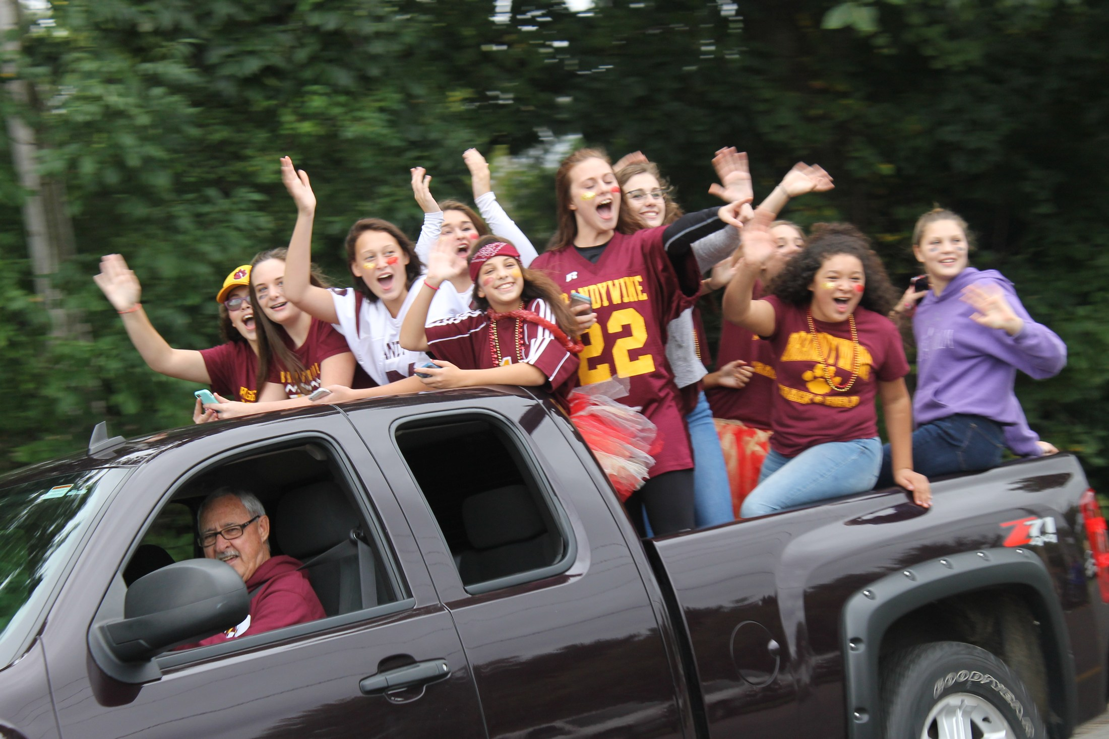 student in the homecoming parade