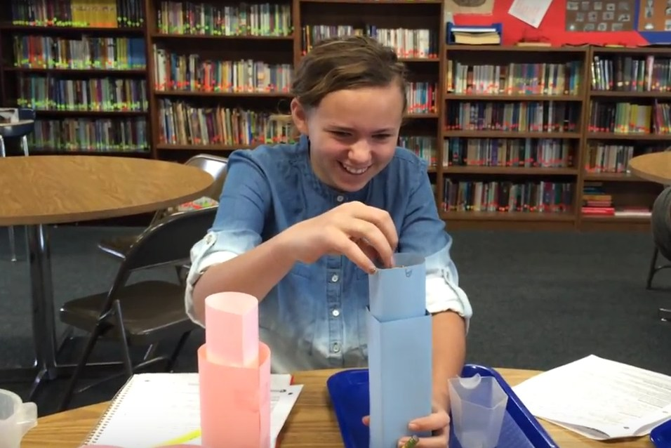 Students doing volume experiment.