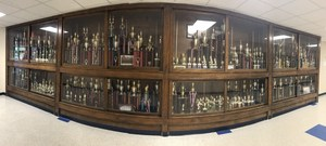 One of several cases of the drill team's trophies at Airport HIgh